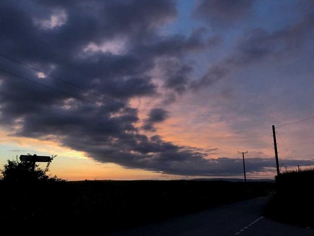 Dark swathe of cloud on the coast