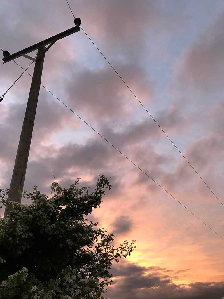 Telegraph pole and clouds