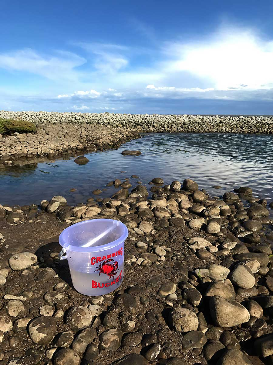 Crabbing bucket and clouds