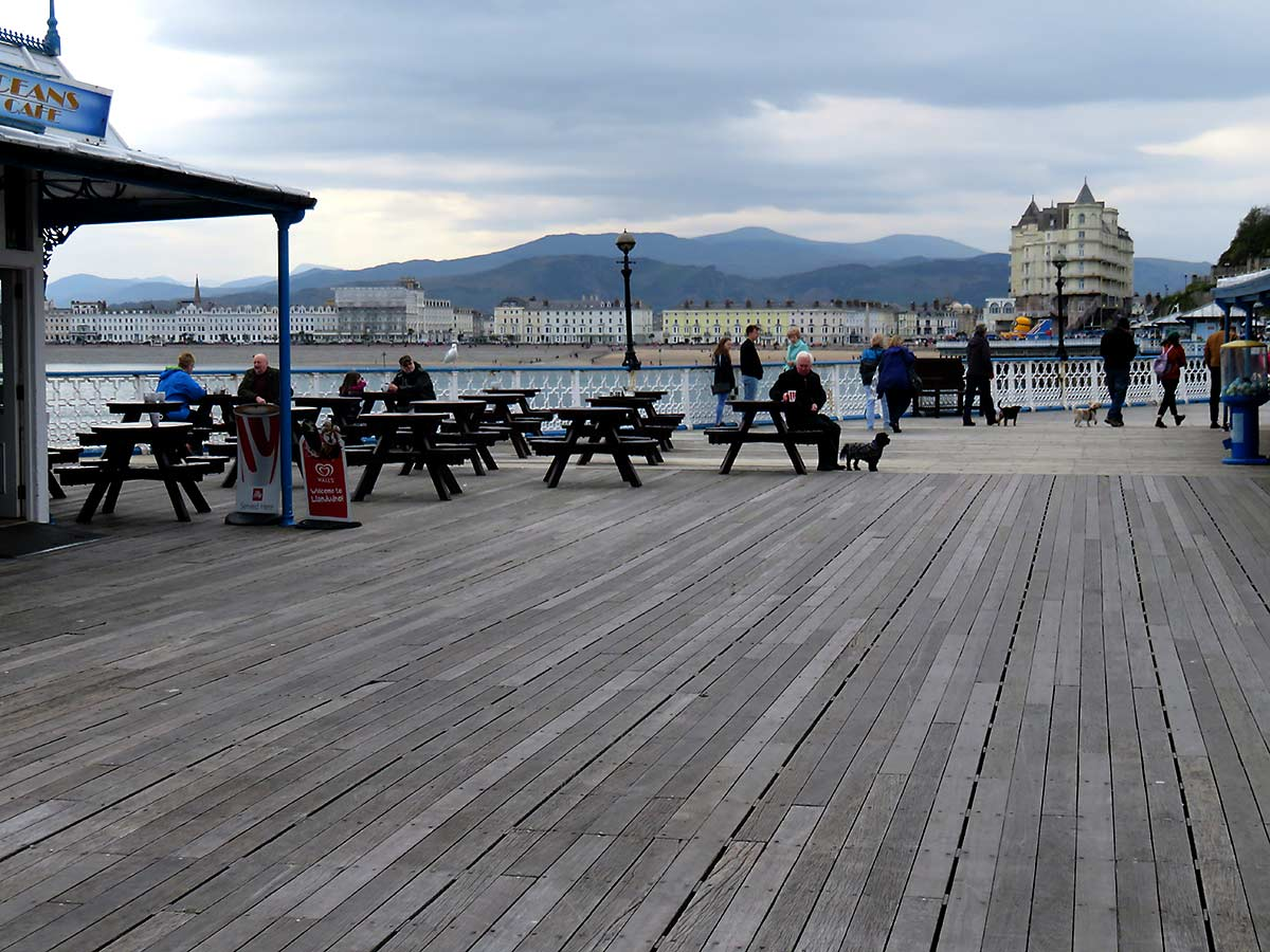 Mountains and pier planks, Llandundo Pier