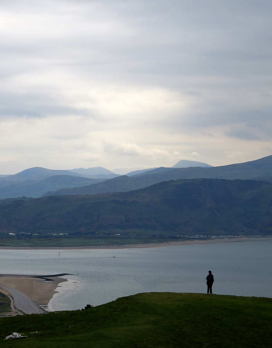 A bystander admires the view from The Great Orme