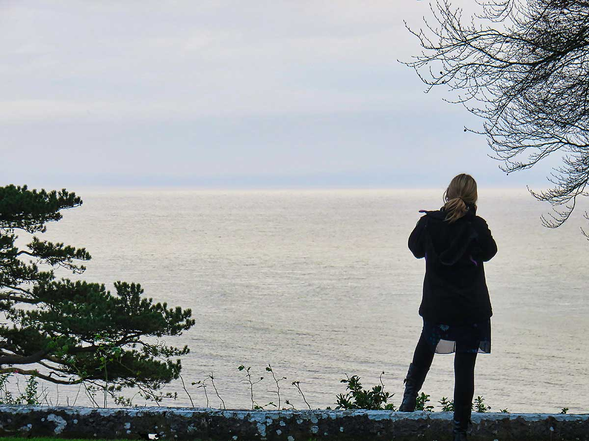 Visitor enjoying the view of the Severn at St Donats Castle