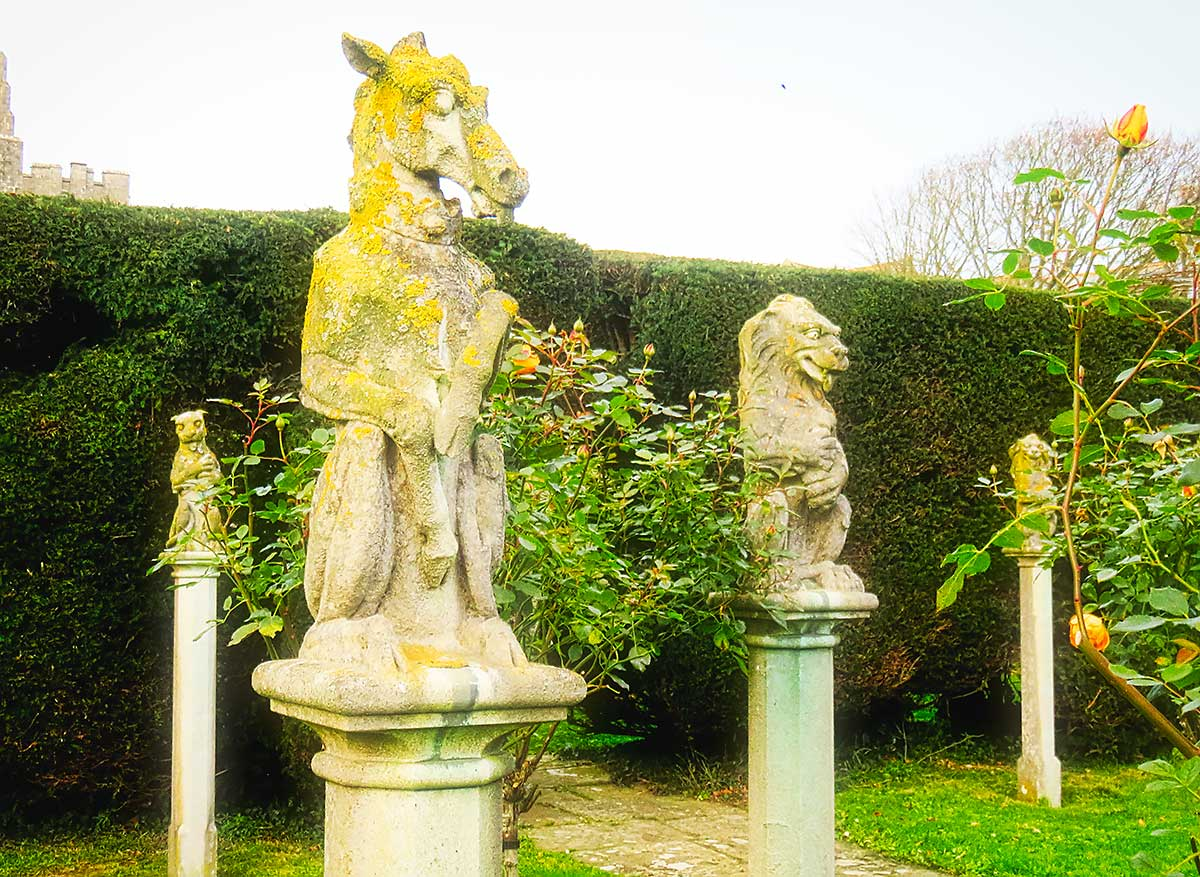 Statues in the rose garden at St Donats Castle