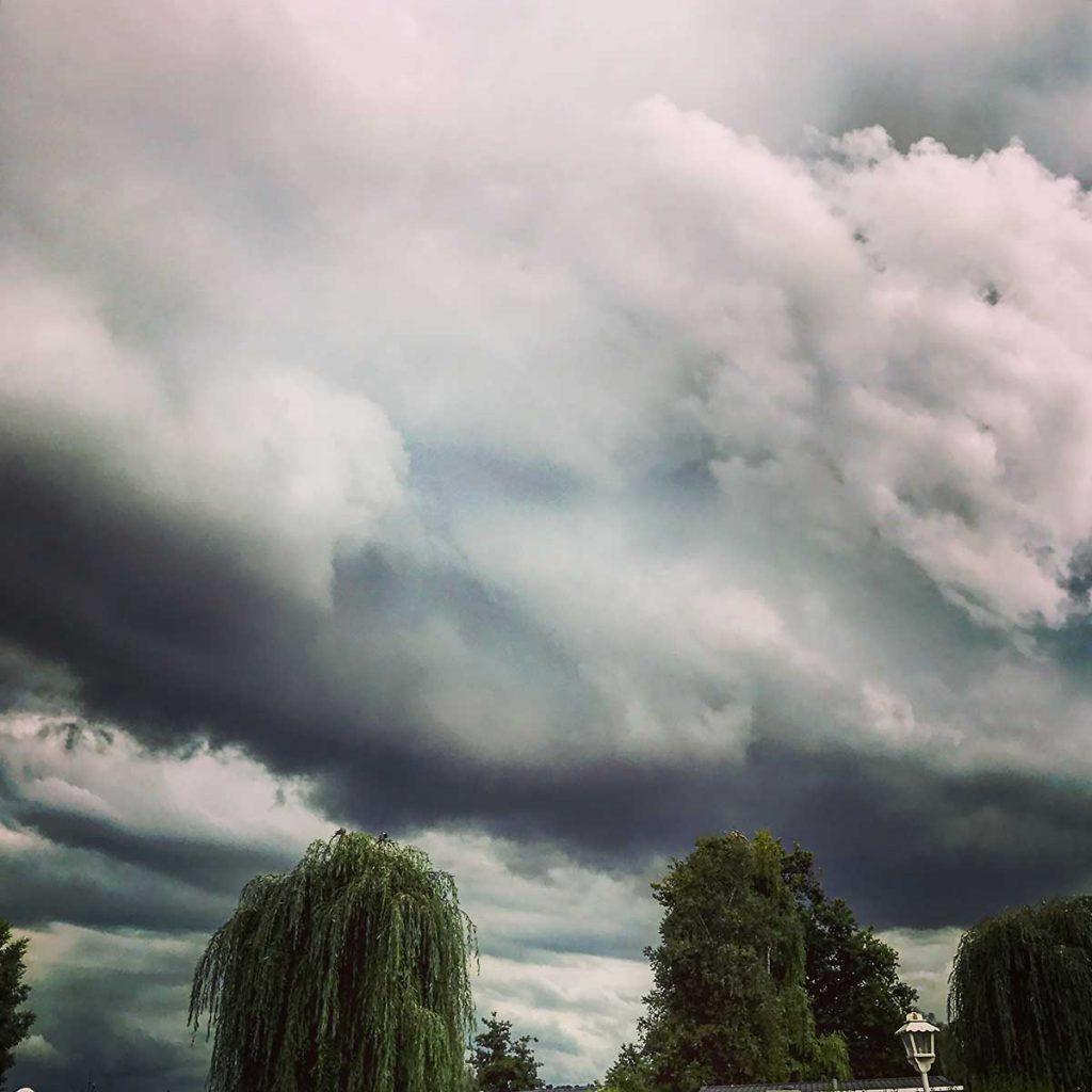 Stormy summer sky above La Croix-du-Vieux Pont, France, August 2017