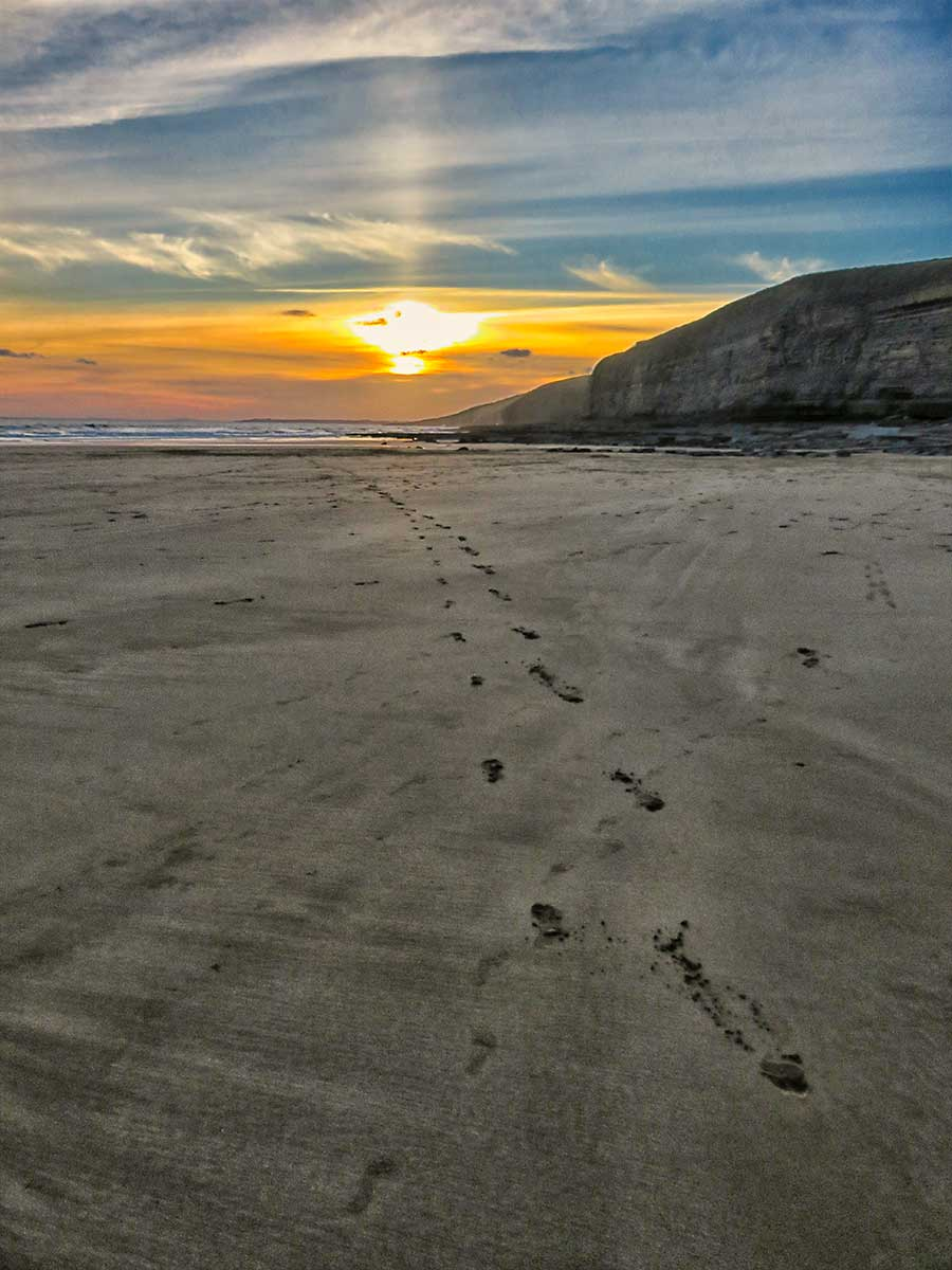 Sunsetting across the sands of Dunraven Bay