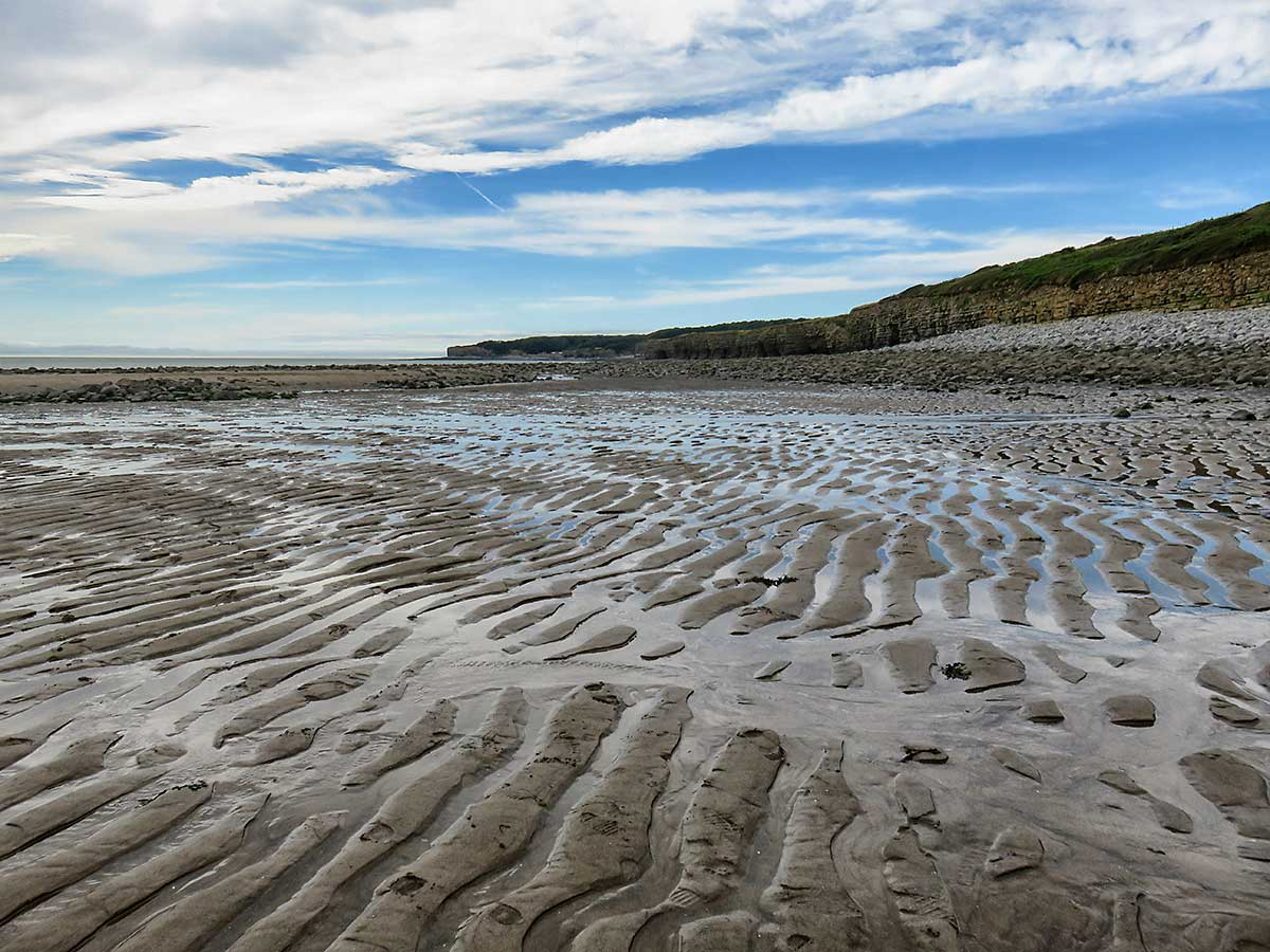 Sand waves on the beach, looking towards St Donats.