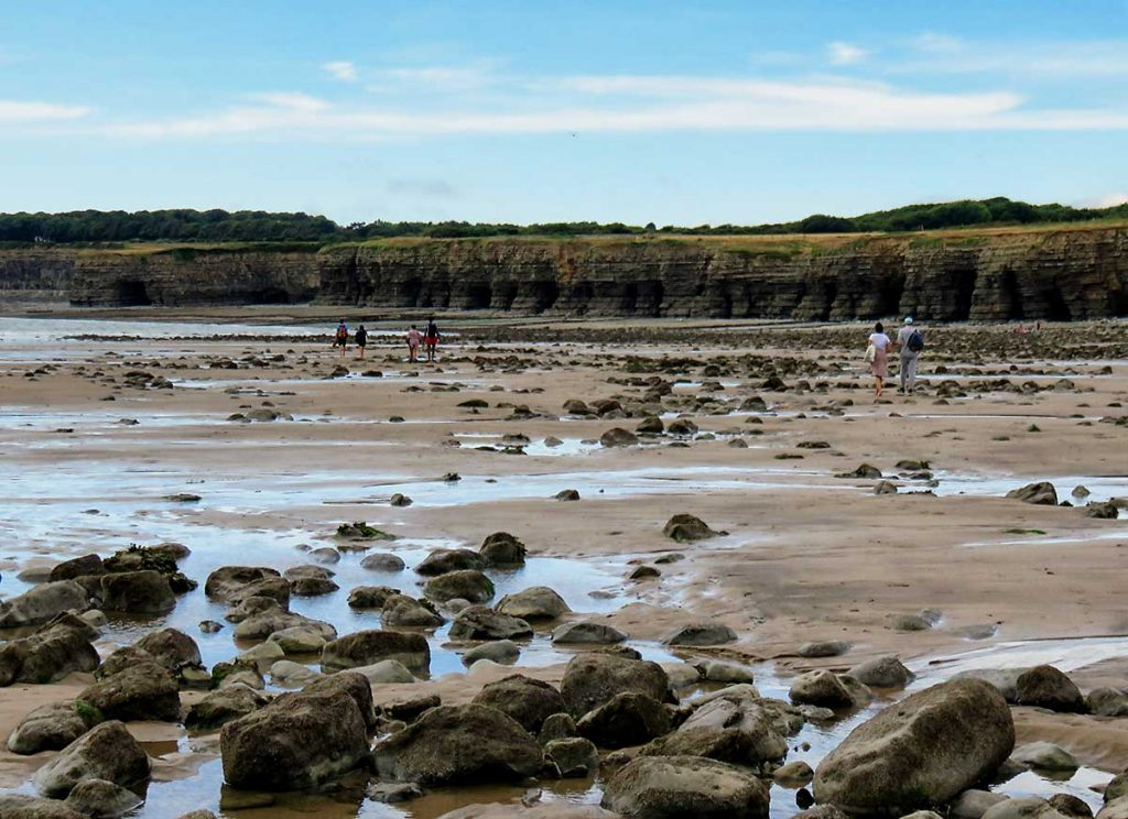 Another family taking a stroll at low-tide on Llantwit Major Beach.
