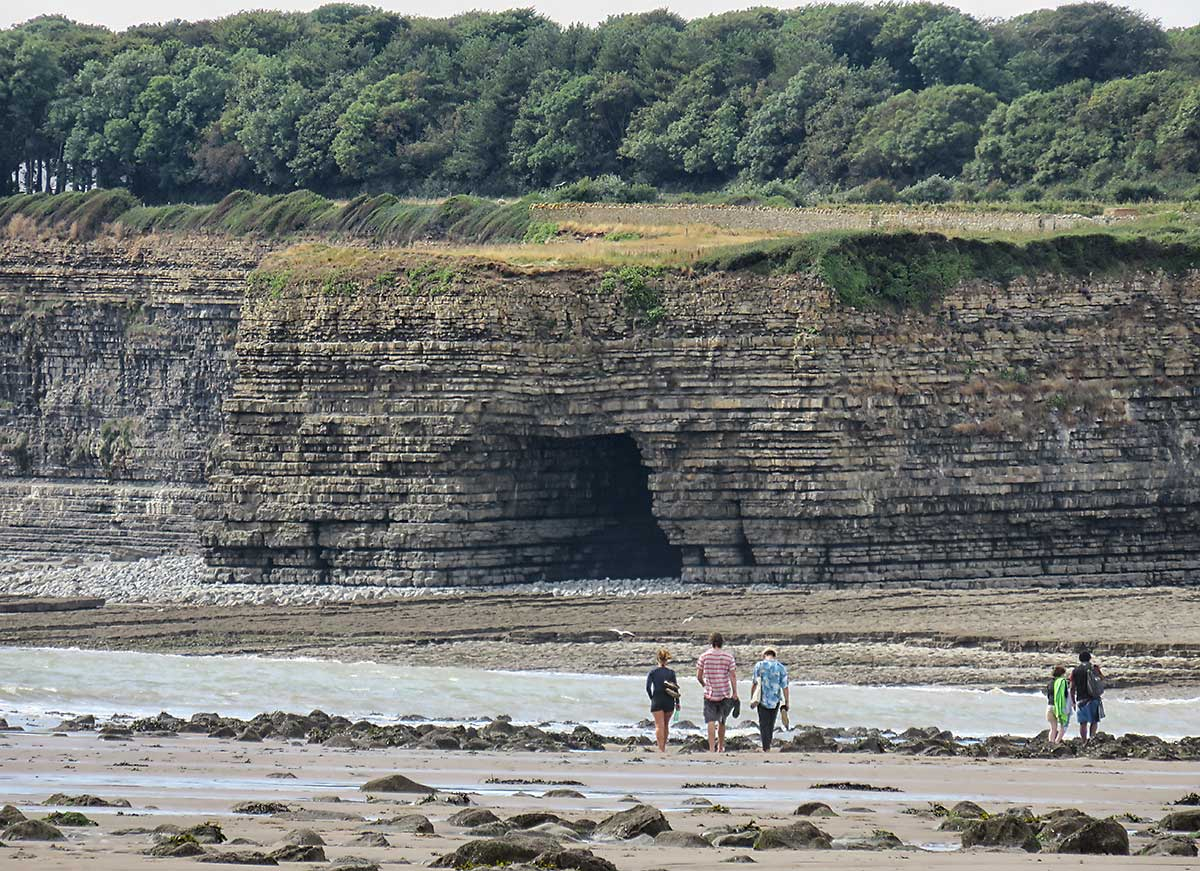 Students returning to St Donats along Llantwit Major Beach.