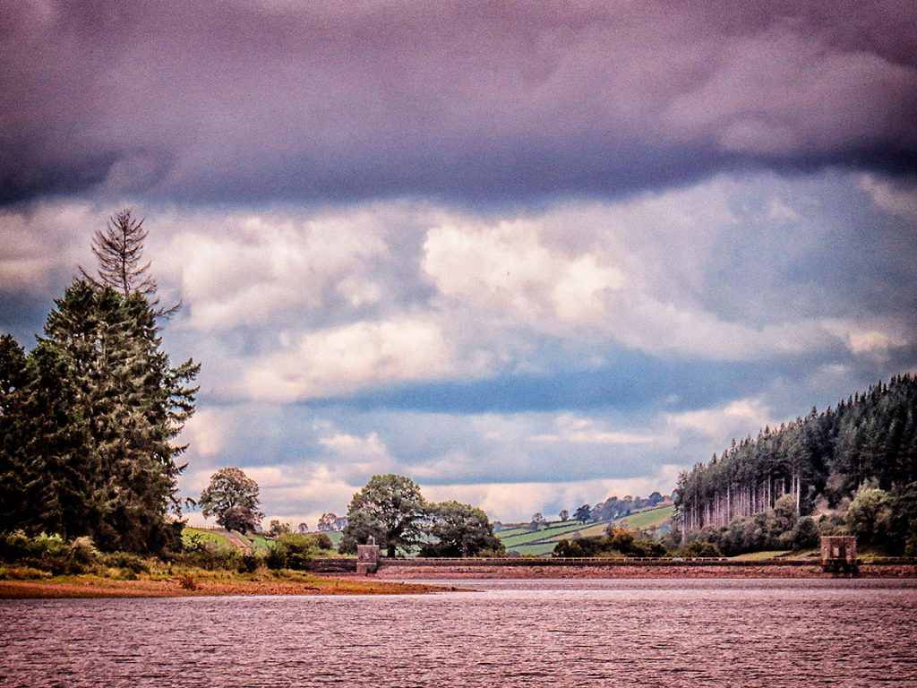 Lowering skies over the end of the dam end of the reservoir.
