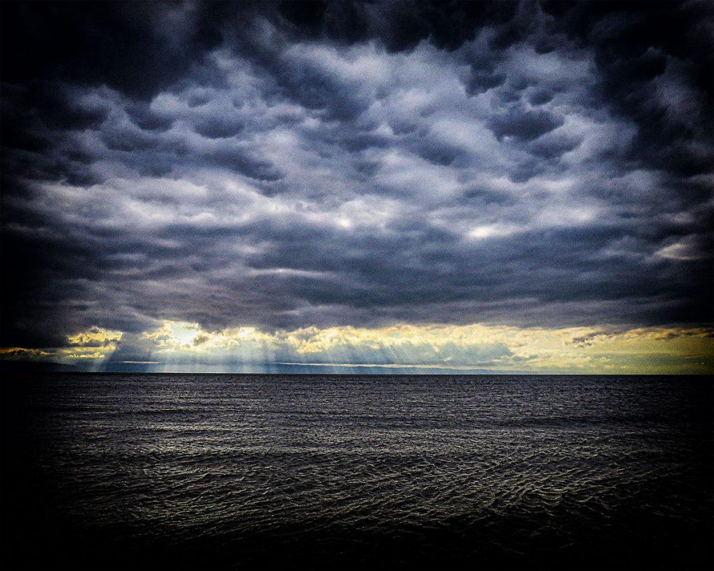 Brooding skies and rays.
