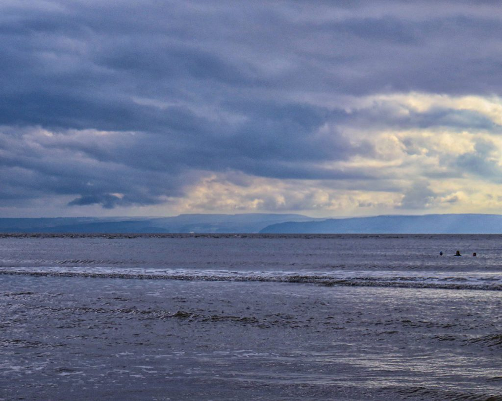Swimmers, Minehead on the horizon.